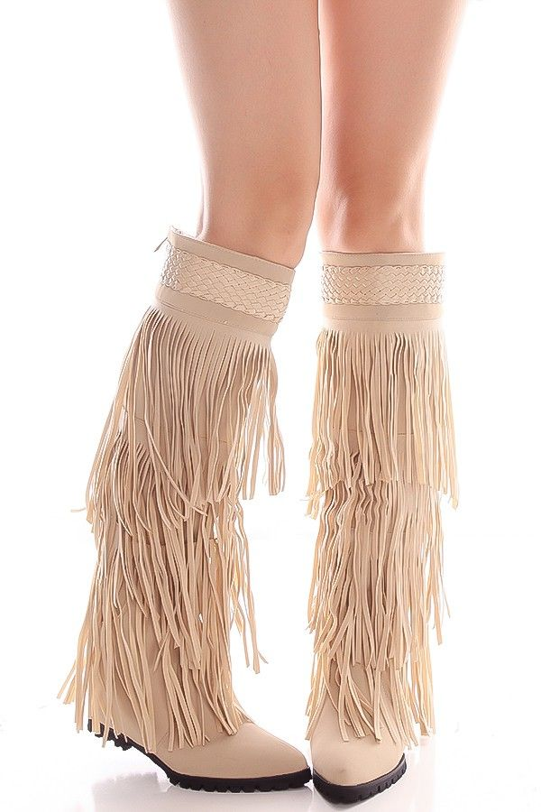 This nude fringe boots features a fringe design with a back zipper with new  buck material.Pointed toe with a hidden wedge measuring at about 3 inches.