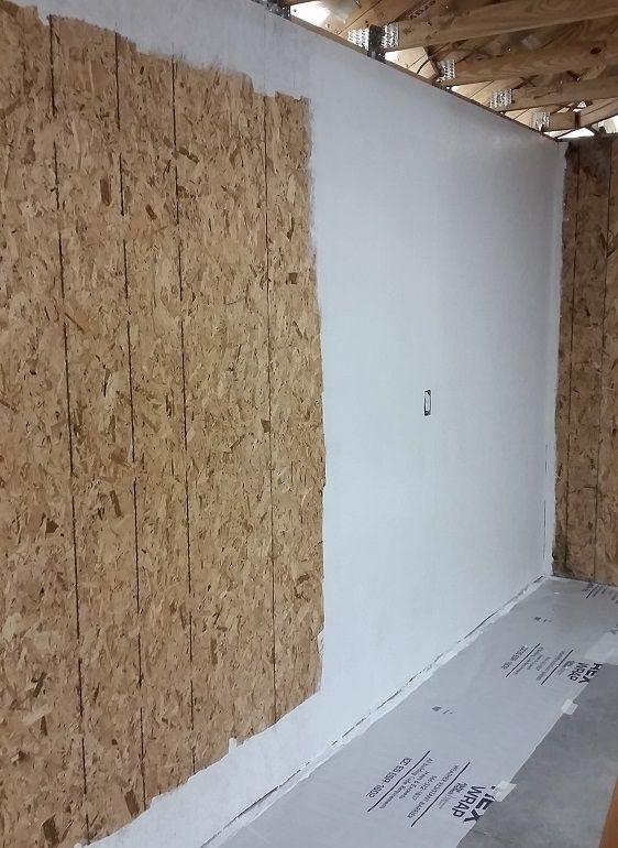 Insulating And Sheathing Garage Walls Pic Painting In Progress Painted Garage Walls Garage Walls Insulating Garage Walls