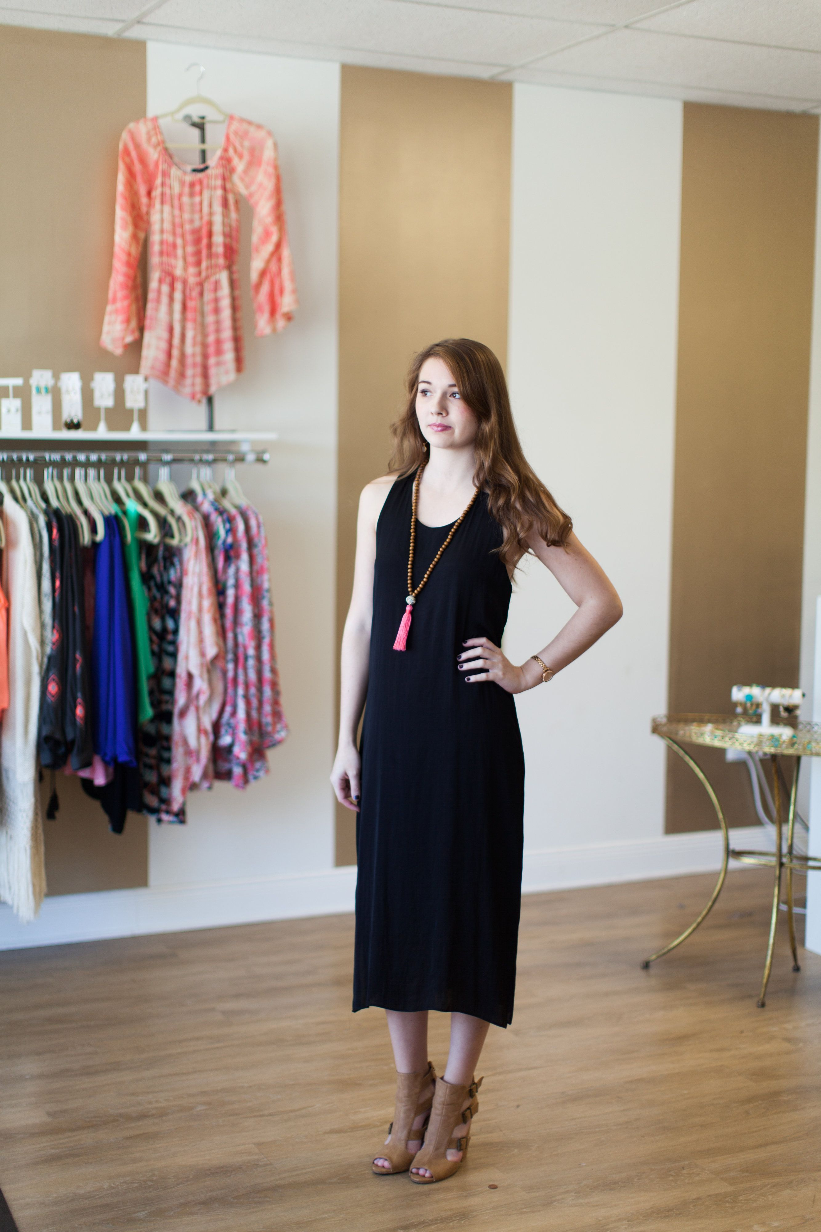 Perfect LBD!!! Black silky dress with racerback and side slits.  The midi length adds a twist to this classic LBD!