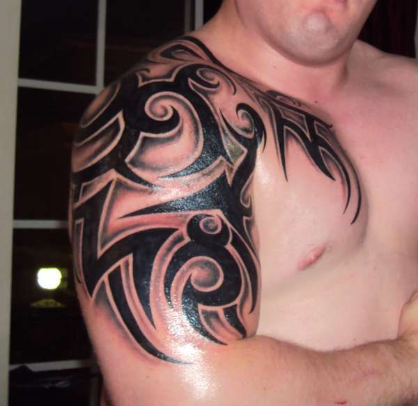 Cool Tribal Chest Shoulder Arm Peice Tattoo