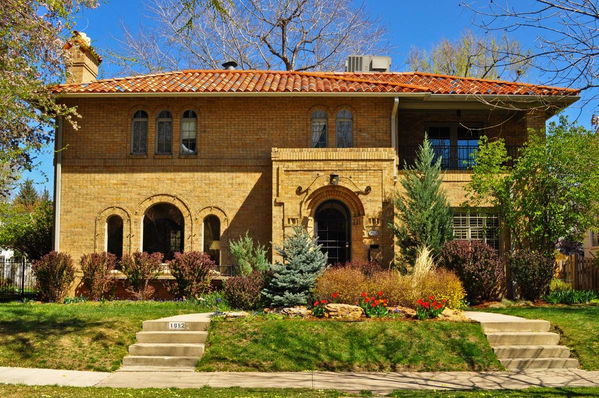 Italian Renaissance/Mediterranean Revival. This Style Features A  Low Pitched Hipped Roof With The Less Common Asymmetrical Façade.