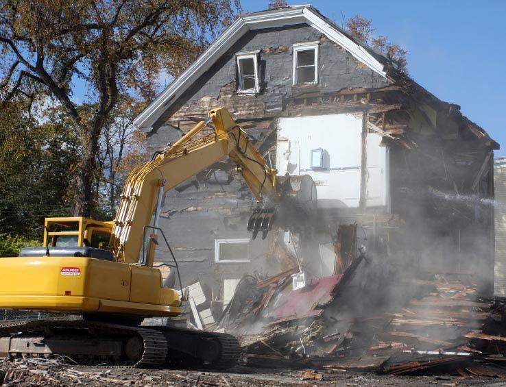 Crews Demolish Asbestos Homes, Neighbors Not Warned Home