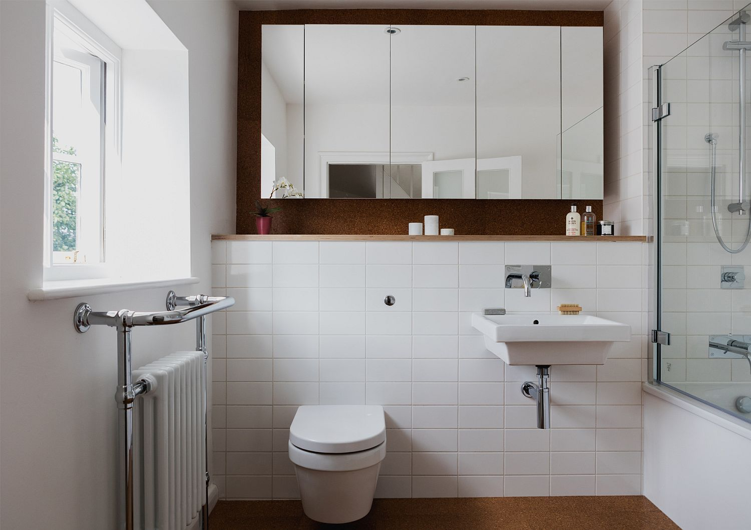 Modern bathroom in white with white tiles and cork floor ...