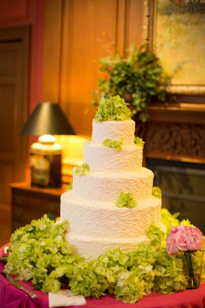 Five Tiered Cake With Decorative White Piping And Green Flowers By