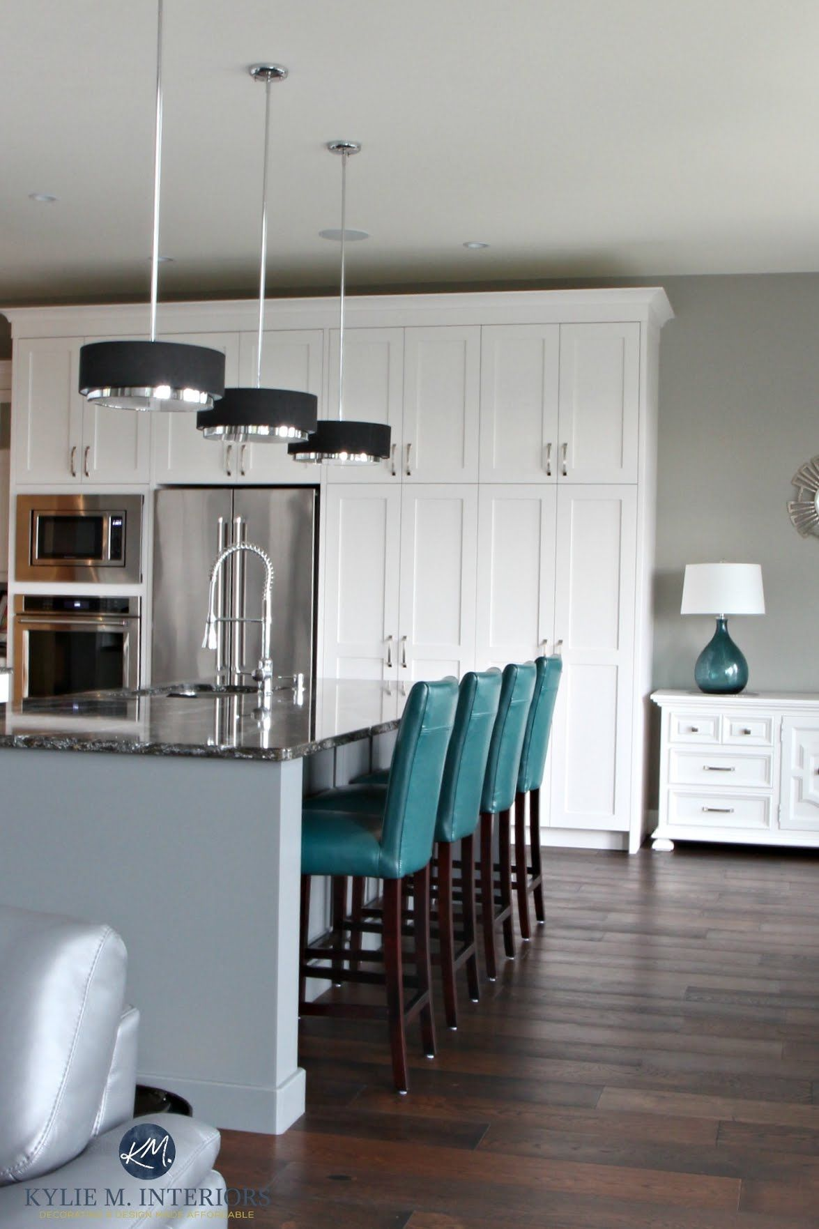 Contemporary white kitchen with gray painted island in