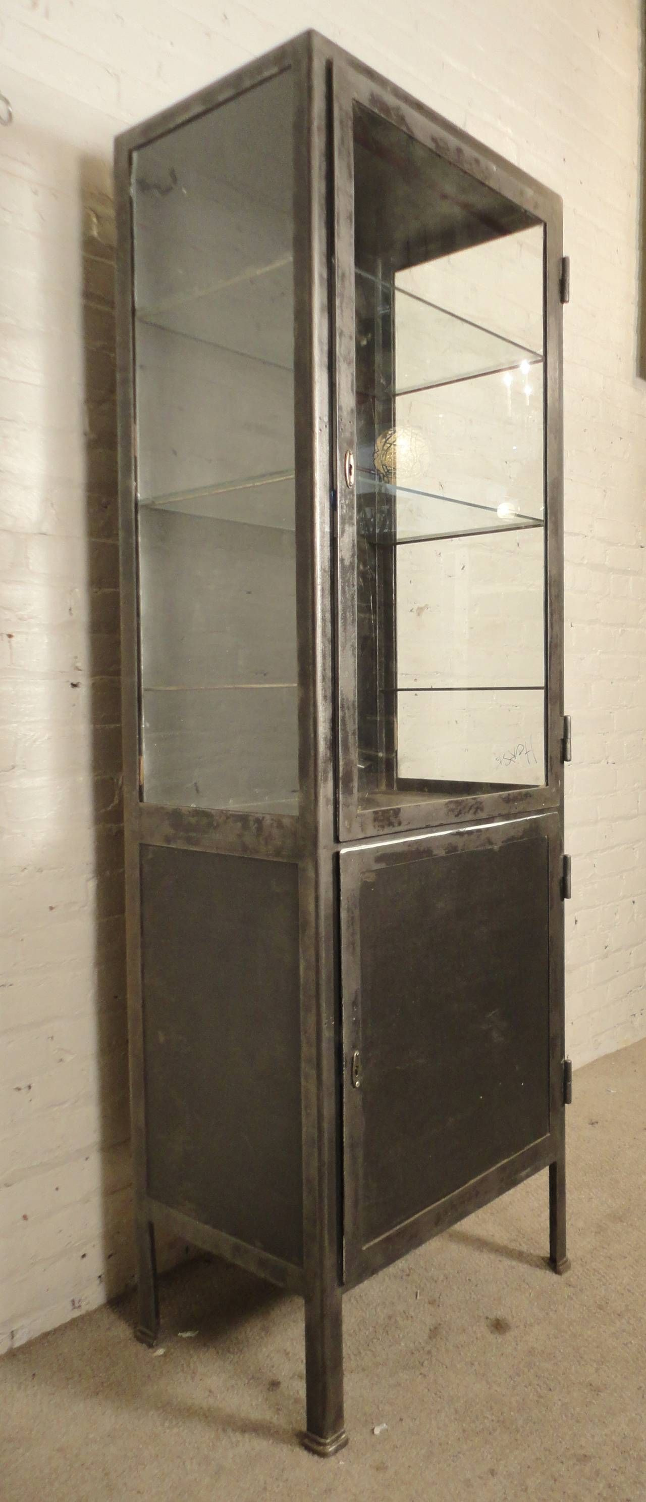 Foyer Display Cabinet : Tall industrial metal display cabinet in entryway