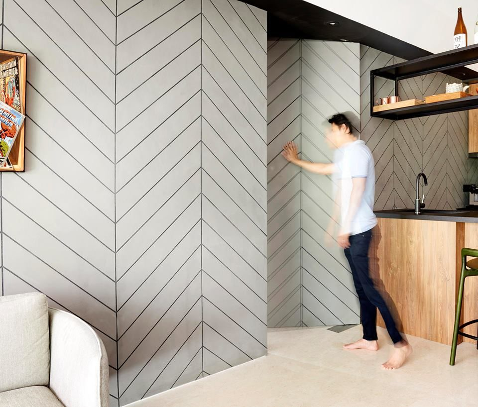 A wall feature that hides the entrance to a bedroom