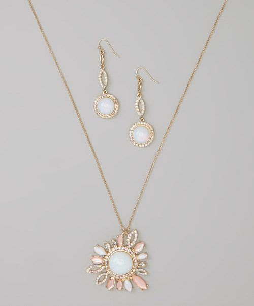 Double up on elegance with this coordinated set. Iridescent marquise gemstones and polished accents craft a pendant necklace to remember, while matching drop earrings lend luminous chic to every turn of the head.