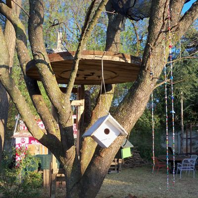 Upcycled treehouse made with a recycle cable drum top. cable drum treehouse