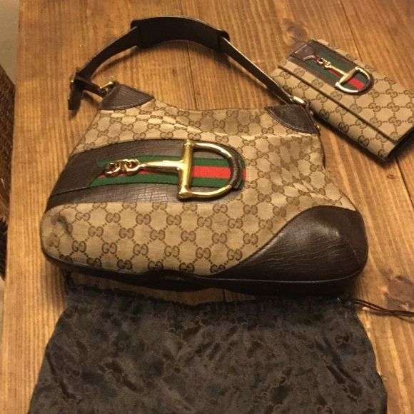 de61ef8938e9 Authentic Gucci D-ring web bag. Brown leather trims with gold hardware, in  excellent used condition. Comes with dust bag. I also have the matching  wallet.