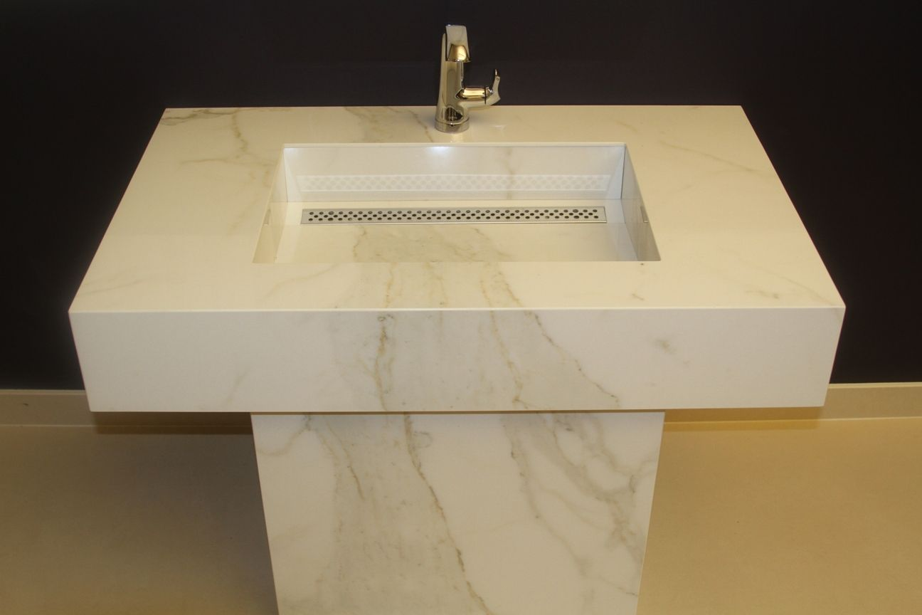 Couture Surfaces New Sink Design Made from large format Porcelain