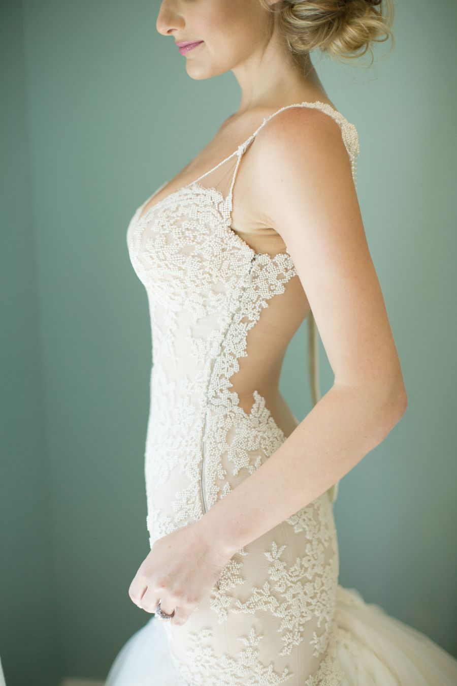 Your jaw will drop further than this brideus plunging back dress