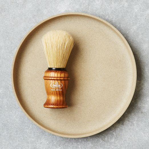 This Wooden Shaving Brush features an elegant ash wood handle and 100% natural boar bristles that will help generate lather for an even, close shave.