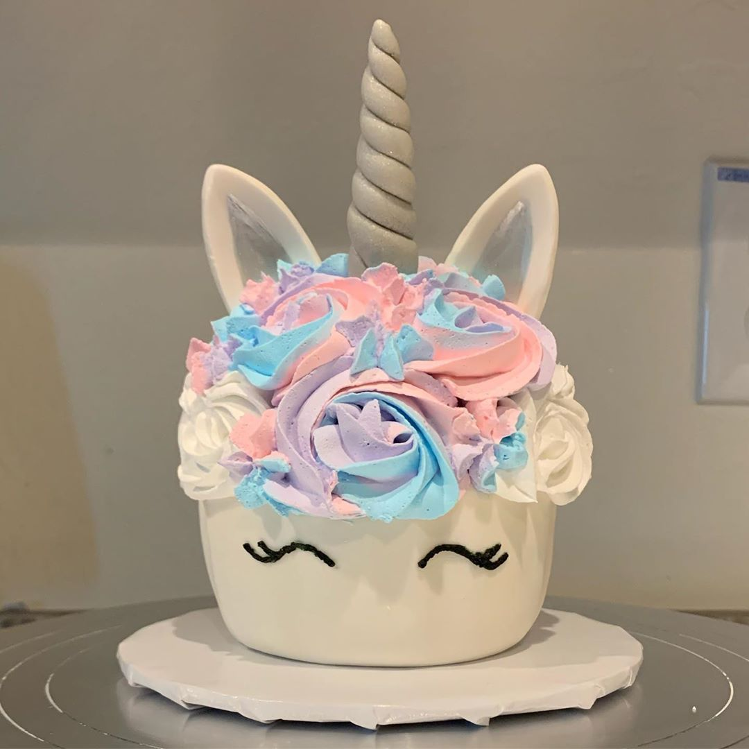 Oversized unicorn cupcake! Chocolate cake with vanilla whipped cream frosting and satin ice fondant (shell, horn, ears)! I may have a new favorite!