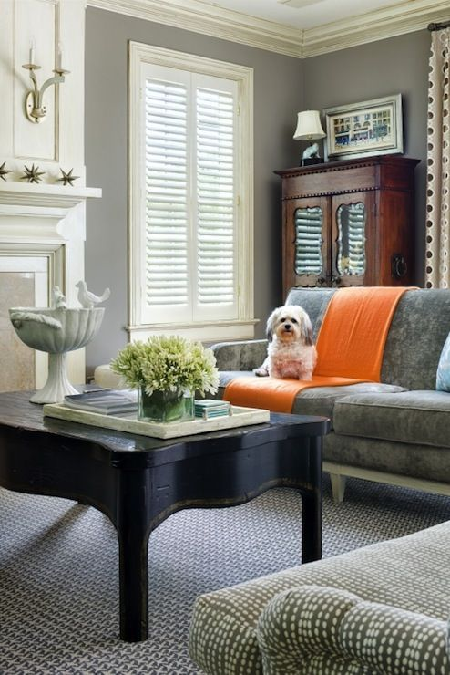 Formal living room with grey walls white plantation