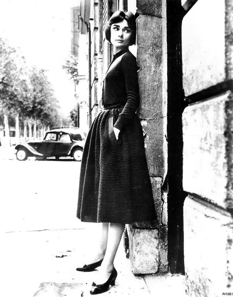 Audrey Hepburn photographed by Sam Shaw, Paris, France, 1957.