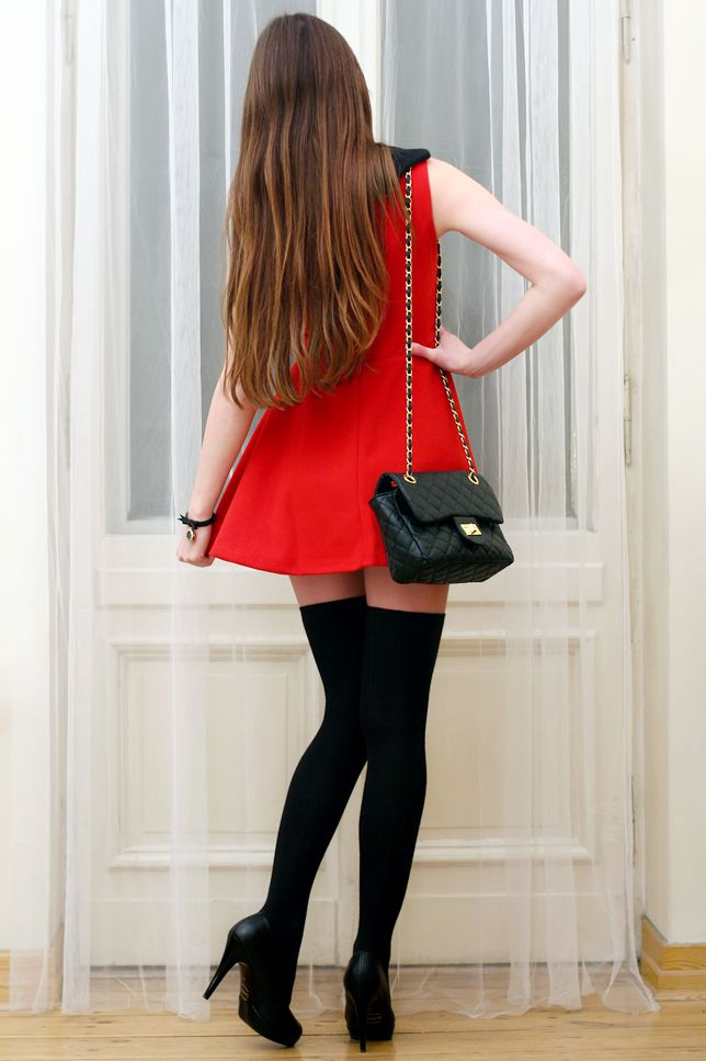 f6a9401eb4e Short red dress with black leather handbag, black thigh high socks ...