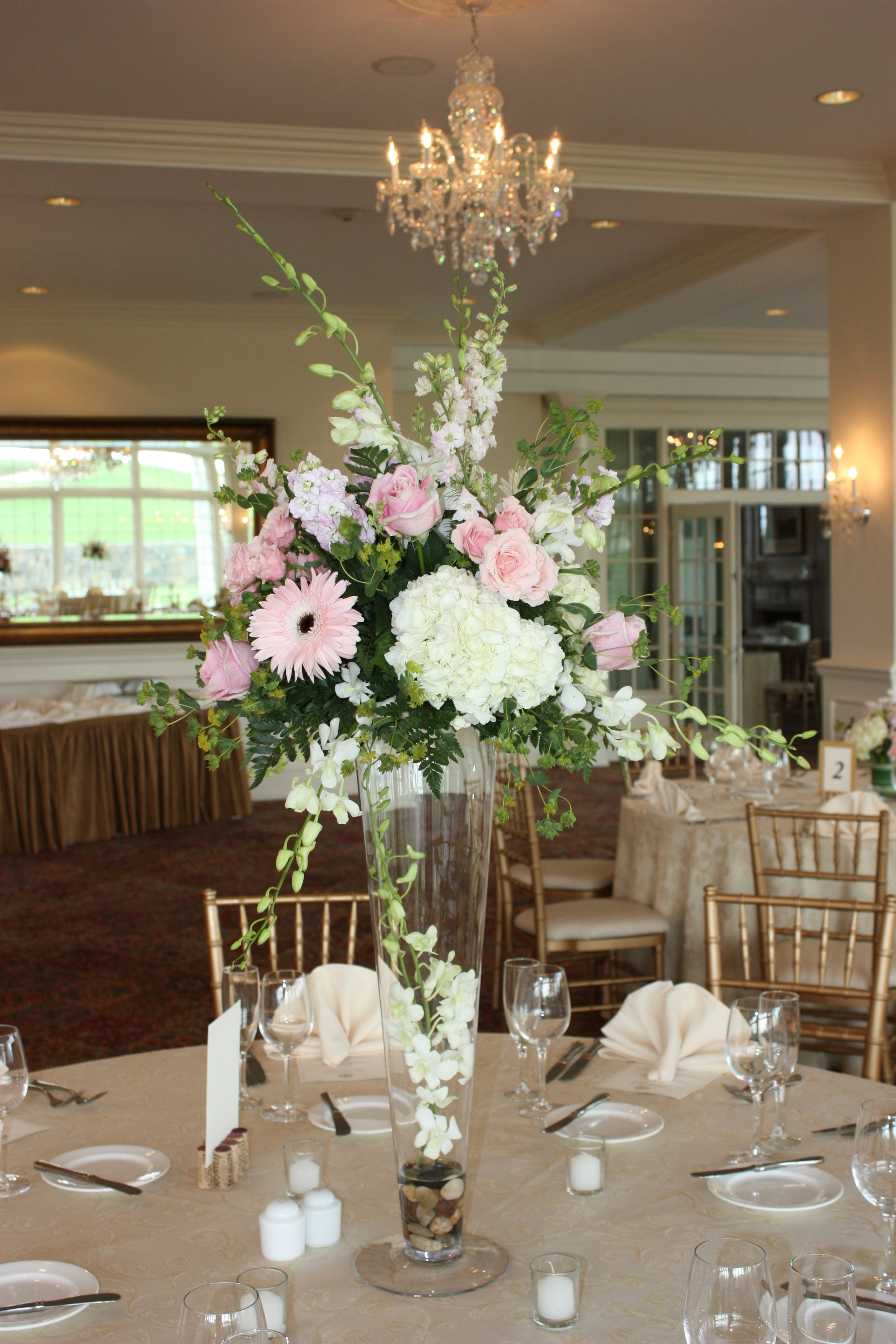 Tall centerpiece in the reception hall | Tall centerpieces ...