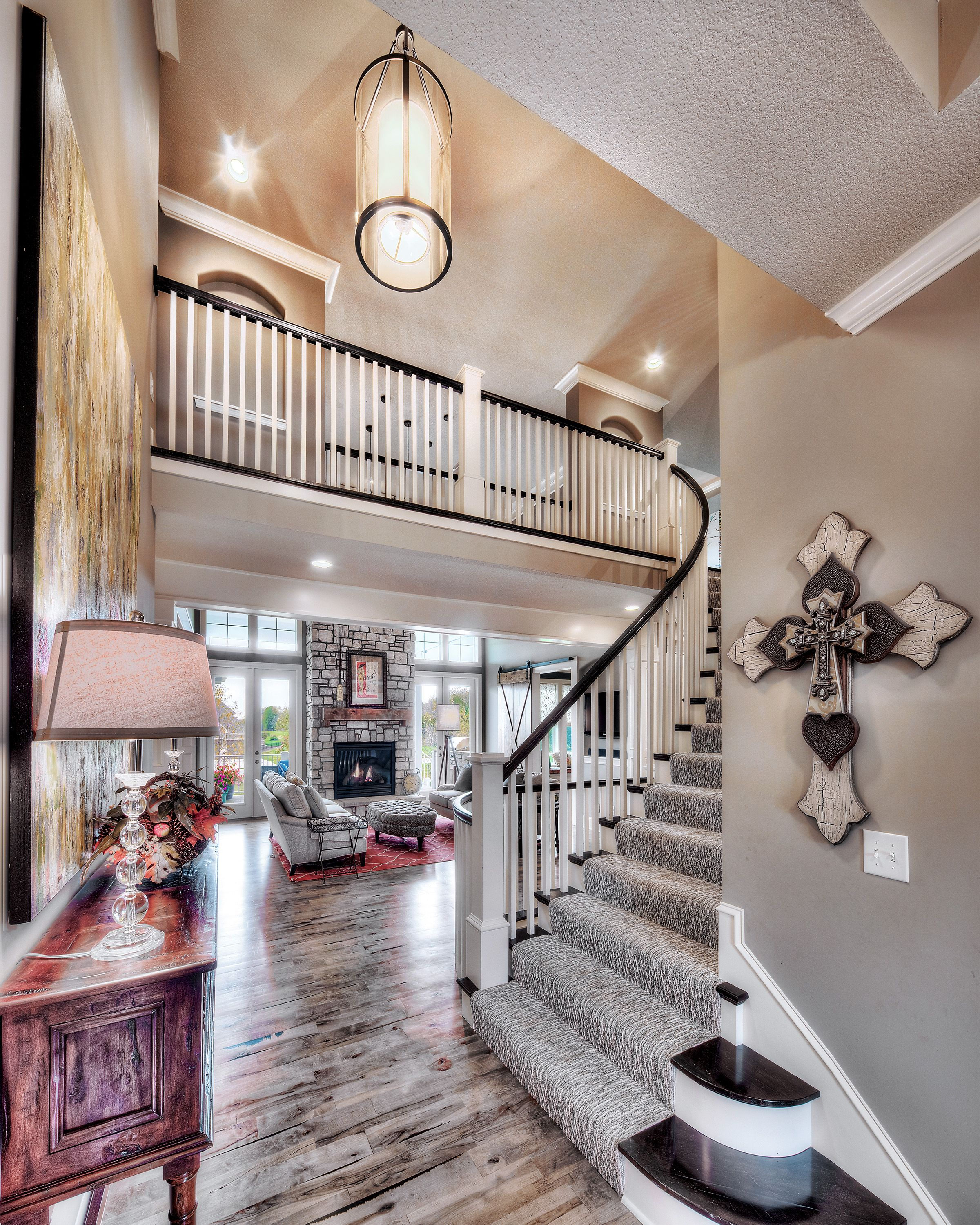 Entry Curved Staircase Open Floor Plan Pendant Lighting