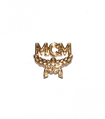 Vintage MCM gold pin  http://www.lazagallery.com/accessoires/mcm-pin-gold