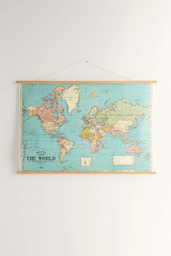 transport yourself to another time and place with these vintage world map posters made into traditional classroom charts wanderlust adventurers