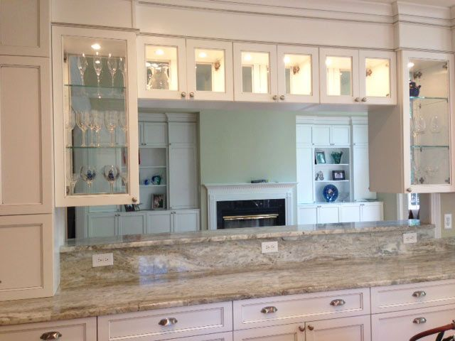 Over range and counter cabinets with double sided glass for Glass upper kitchen cabinets