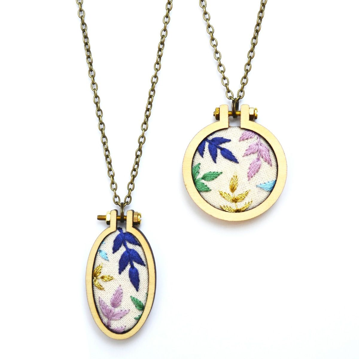 Inspired by the return of spring, this necklace features hand embroidered foliage with metallic gold detail. Wooden hoops are made from sustainably...