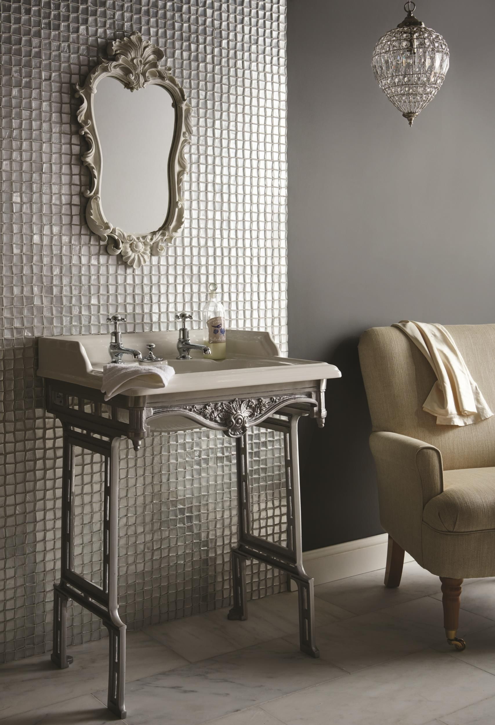 ares metallic glass mosaics feature a unique irregular shape which is a great twist on square