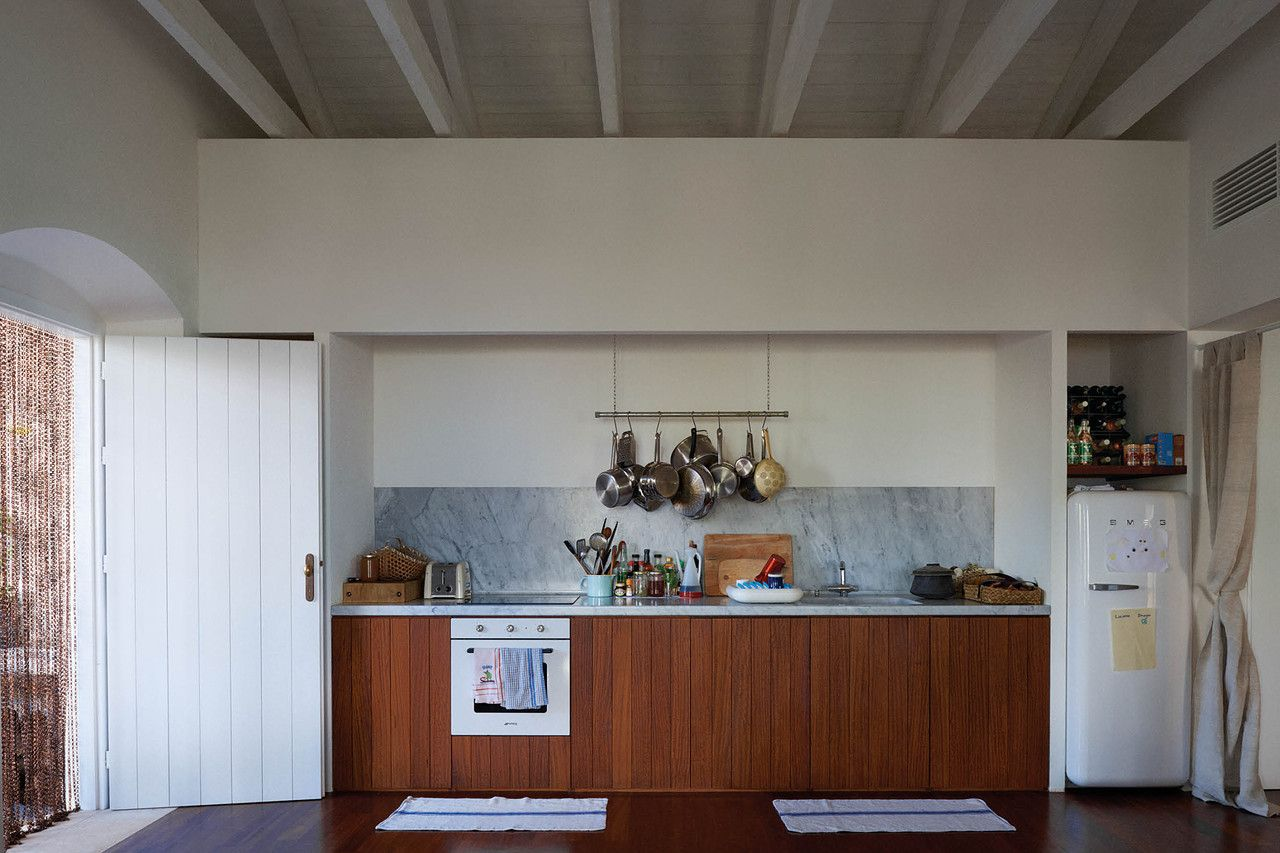 The kitchen, with Carrara marble counters and appliances from Newson's collaboration with Smeg