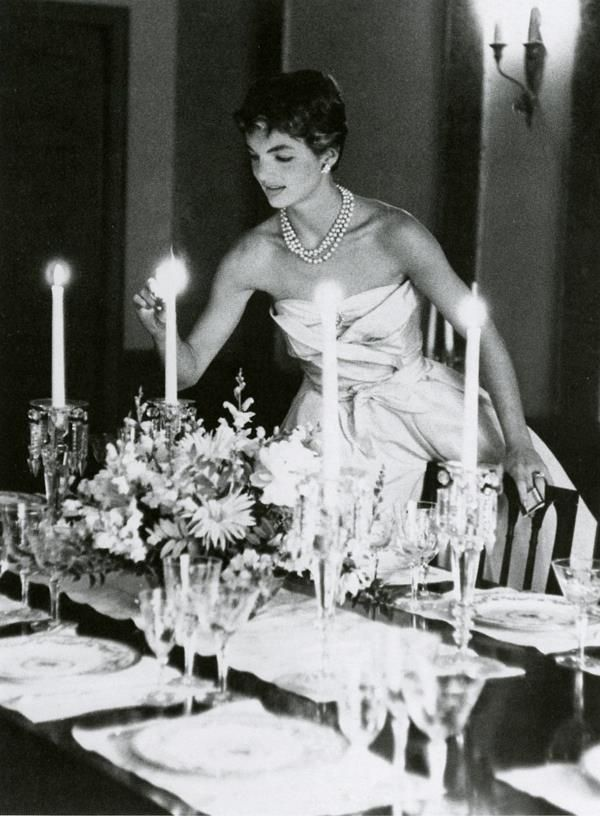 Jackie Kennedy preparing for the young couples first dinner party at their Georgetown home on Dent Place, May 1954. Photo by Orlando Suero