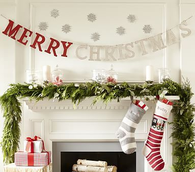 merry christmas garland for family room stocking on one side vs in the middle