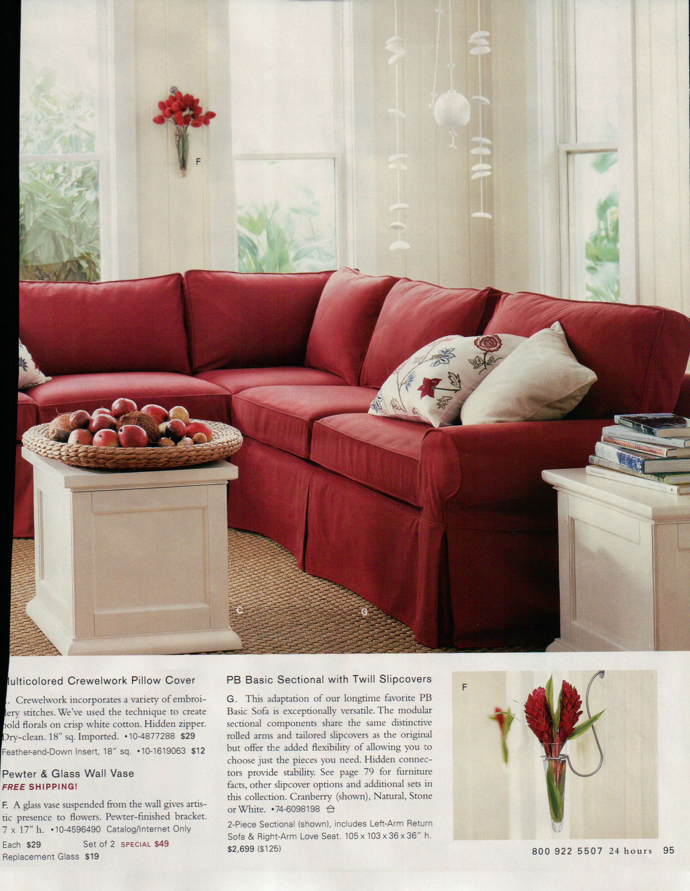 Red couch with white accents and natural rug