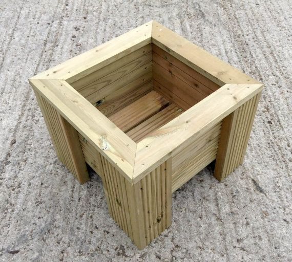 Premium Large decking wooden garden planter,  Wood Trough Handmade Square Plant Box is part of Wooden garden Planters - Premium Square Wooden Decking Planter Our garden planter is expertly crafted at our timber yard, based in Devon  We use high quality, long lasting pressure treated wood  This makes the wooden garden planter long lasting and looks great! All our planters come ready made!  This premium planter is a great size for placing in corners of empty spaces  With the unique edge to it not only does it look stylish but brings a fun look to your outdoor or indoor area  The smallish size means it is ideal for using indoors, with the legs keeping it up, not only does it look great but this trough is very practical  This trough can be used for planting herbs, flowers and lots of type of plants  They can be used for indoor and outdoor use  Each of our planters has drainage holes at the bottom, making it ideal for growing plants  Growing herbs and flowers in this wooden planter can be very practical and easy  They can bring colour to any Garden, Decking, Patio or Conservatory area! Please see below our expertly chosen seeds and compost, ideal for this planter  DIMENSIONS Height  360mm Inside Depth  220mm Width  470mm Square All our planters are within 10mm of these measurements   Each planter has holes in the base for drainage  These planters are really high quality and will last for years!