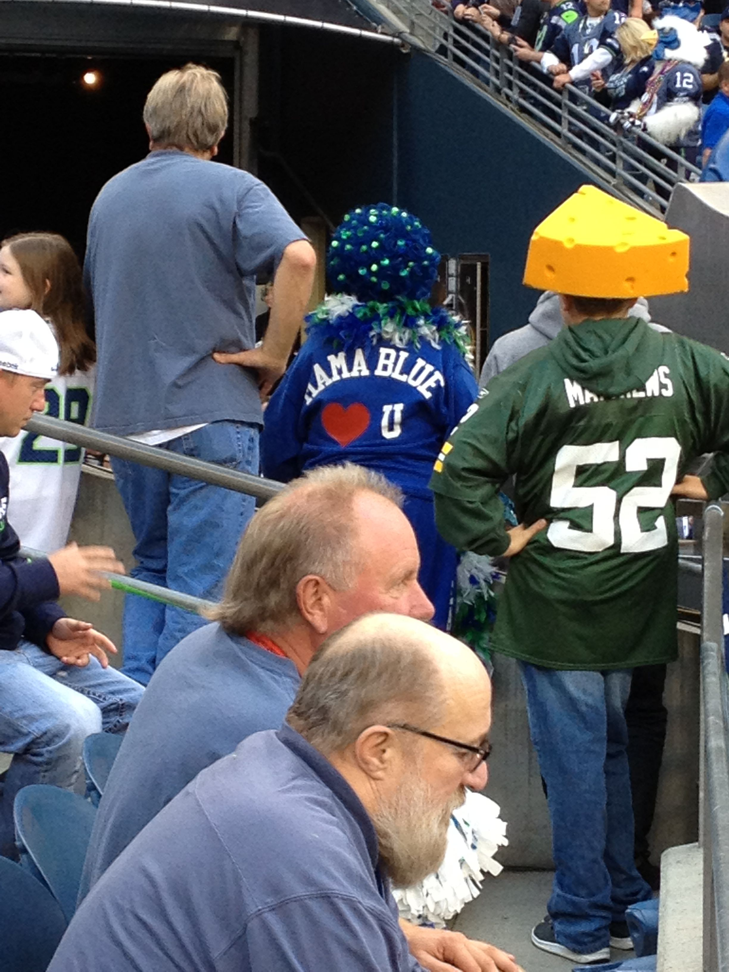 eb7e96eeb Seattle Seahawks Mama Blue next to a Green Bay Packers cheese head ...