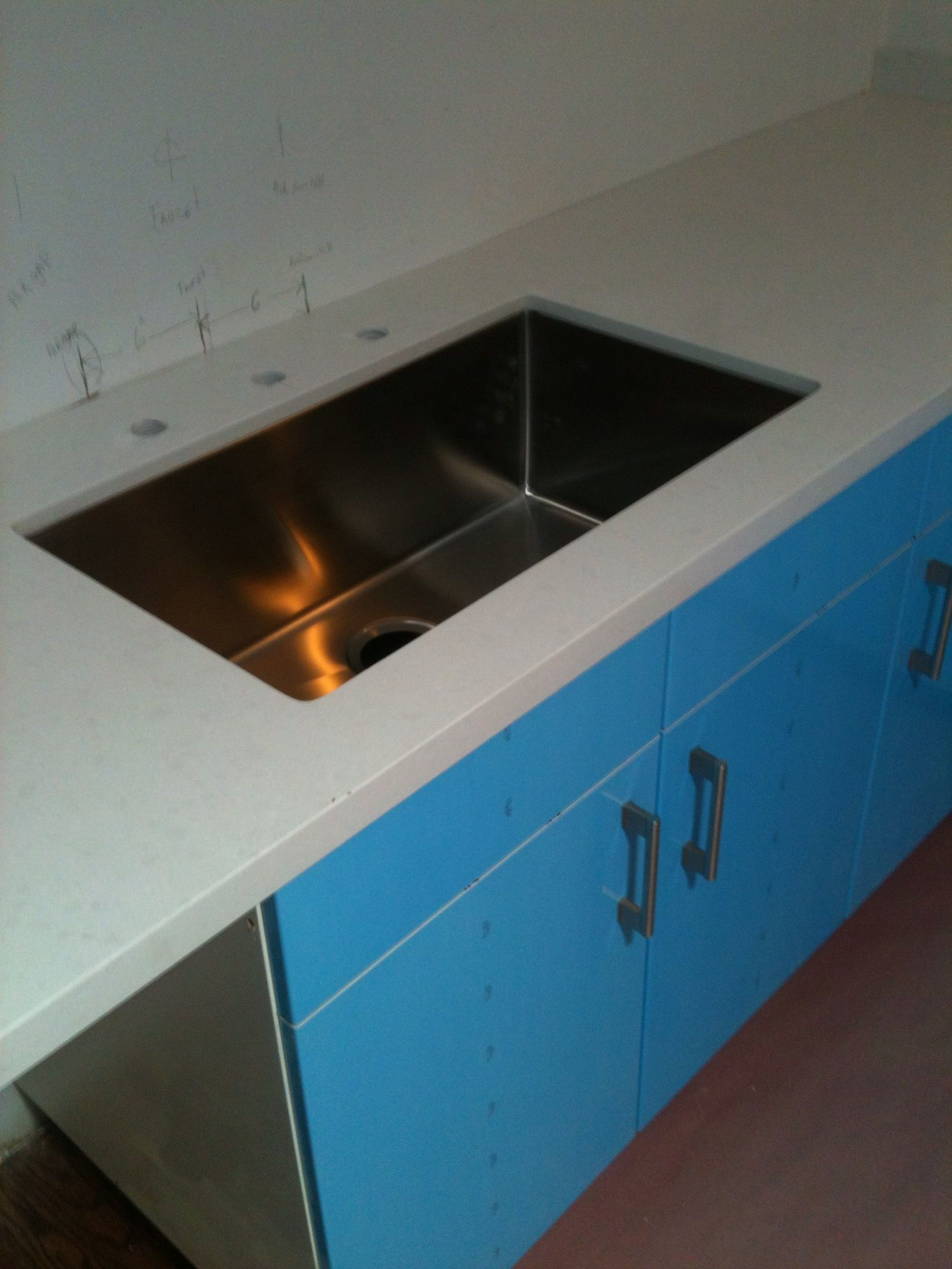 Counter and sink in! Just needs faucet and air gap and garbage ...