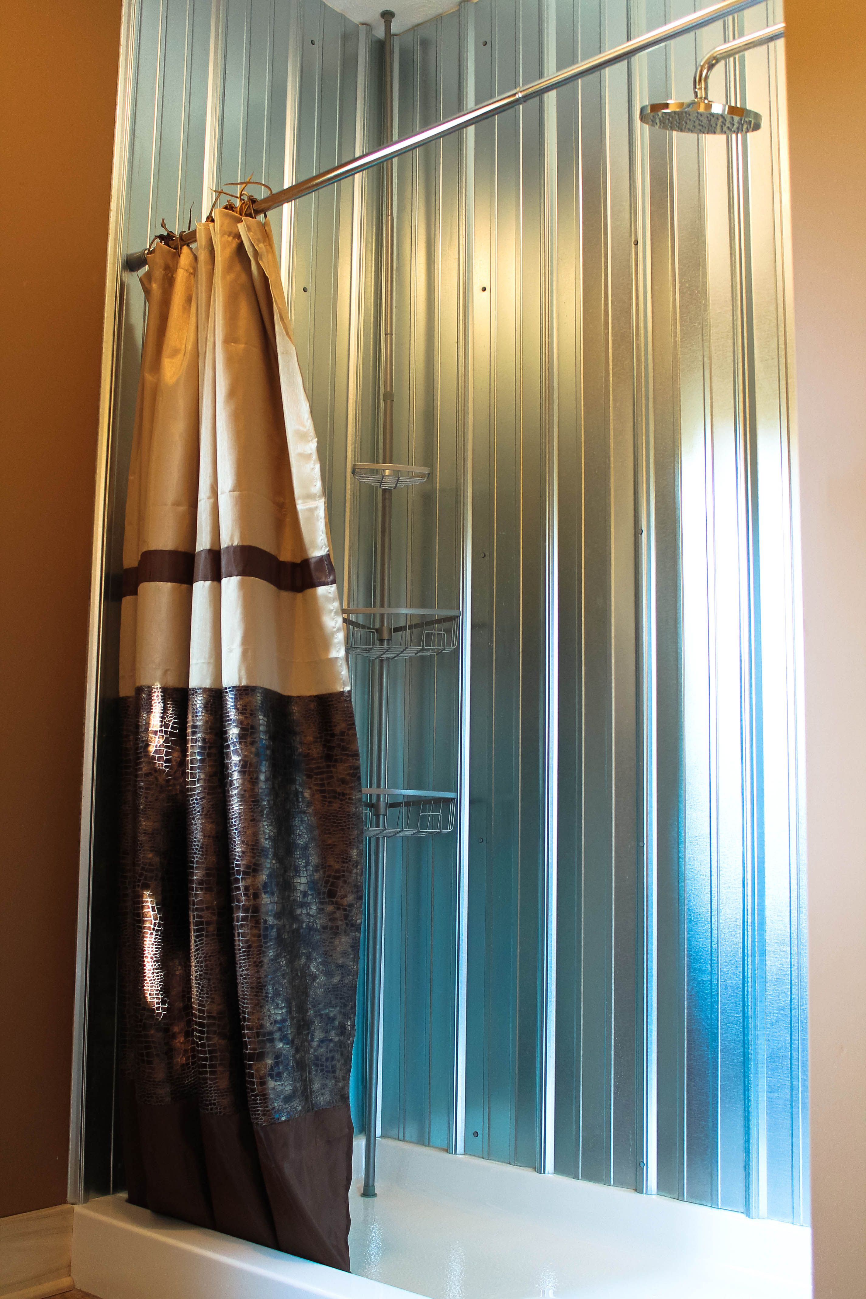 Galvanized Metal Shower Walls Made Of Barn Siding With A Rain Head