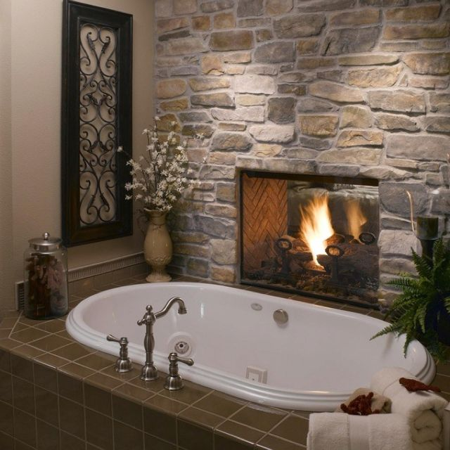 Bathroom with double-sided fireplace