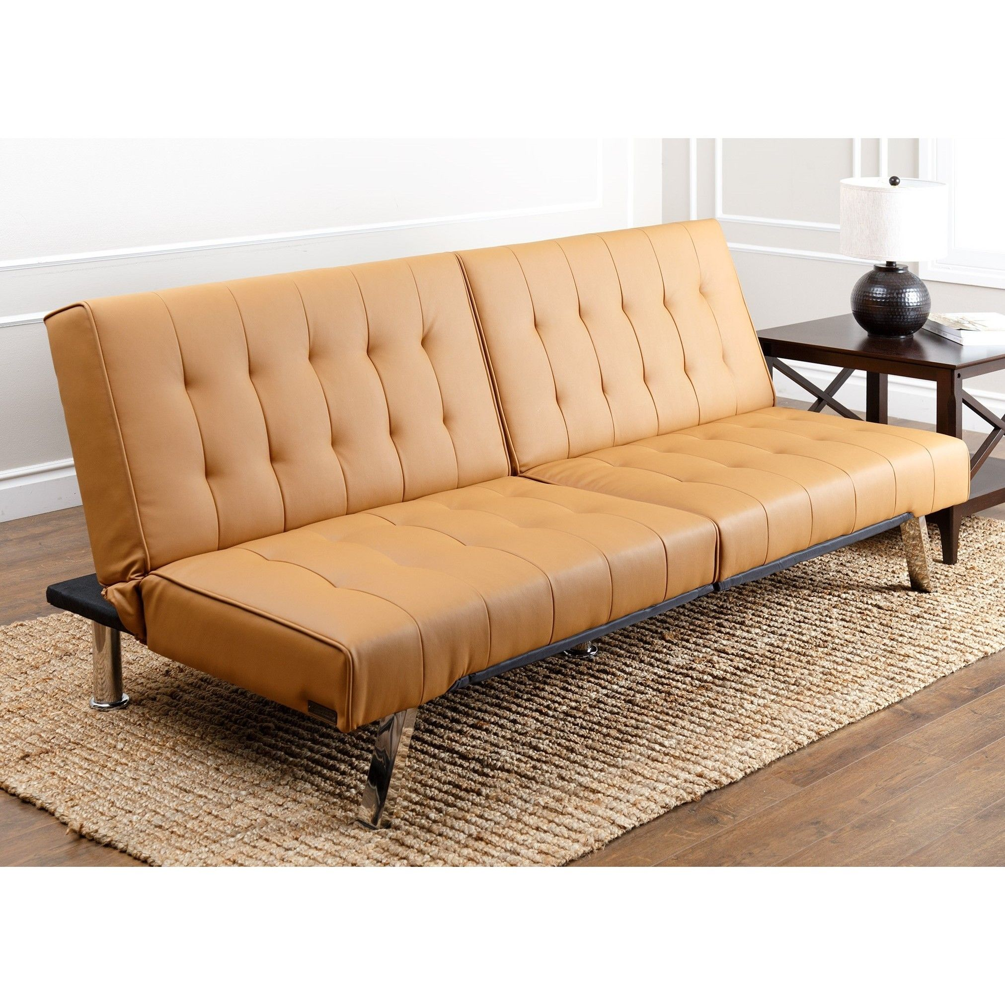 - The Rich Toned Leather Upholstery Of This Futon-sofa Establishes