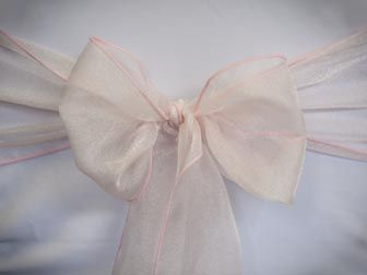 Chair Rentals- Light Pink Organza Chair Sash. Complete the look with a matching table runner or napkin. Check out our other fabrics at Eventrentalutah.com or follow our board on Pinterest