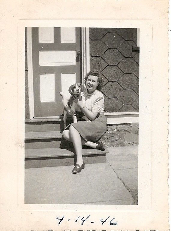 1940s photo of woman holding a beagle.#vintage #photography