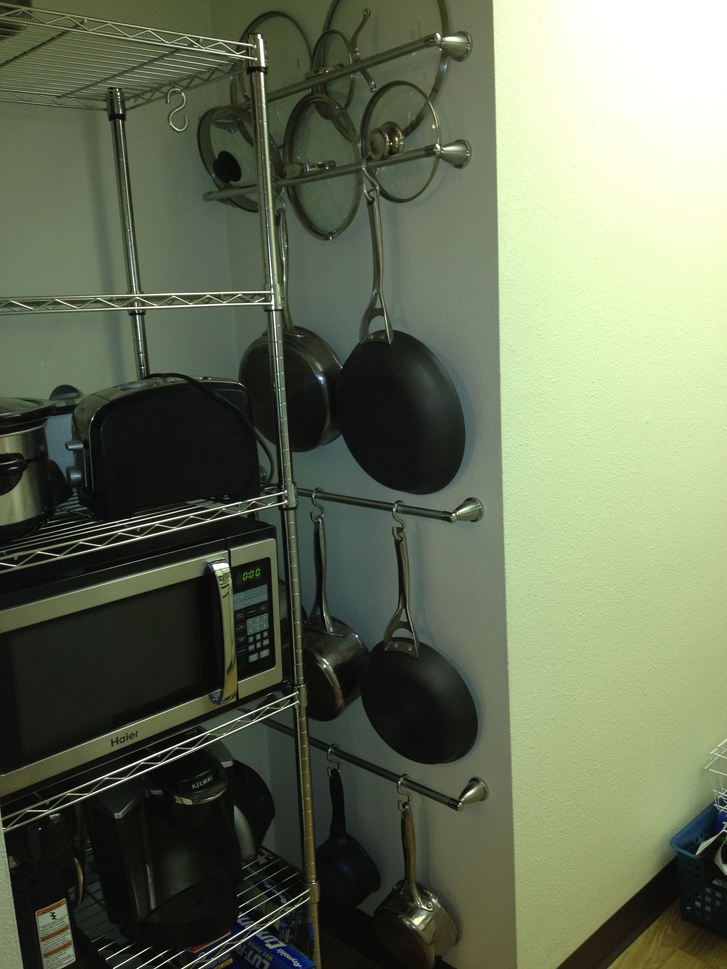 Using towel bars and s hooks to hang pots and pans on the for Kitchen s hooks for pots and pans