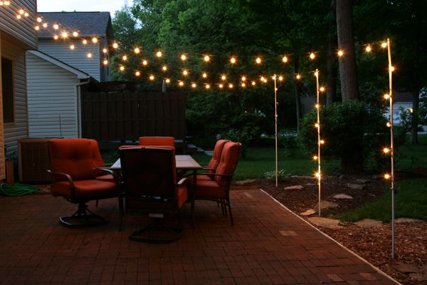Support poles for patio lights made from rebar and for How to hang string lights on trees