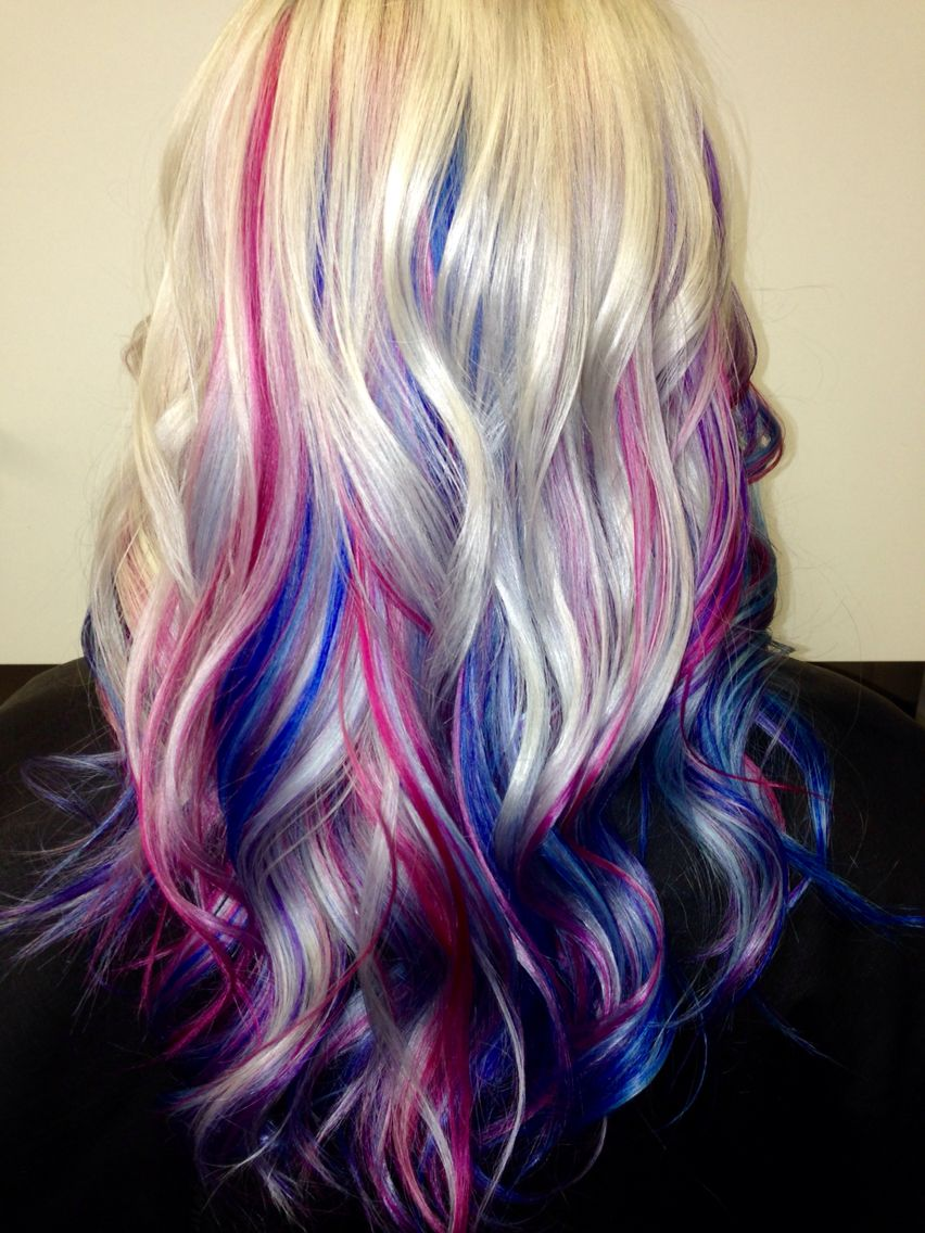 Platinum blonde hair with blue, pink and purple streaks ...