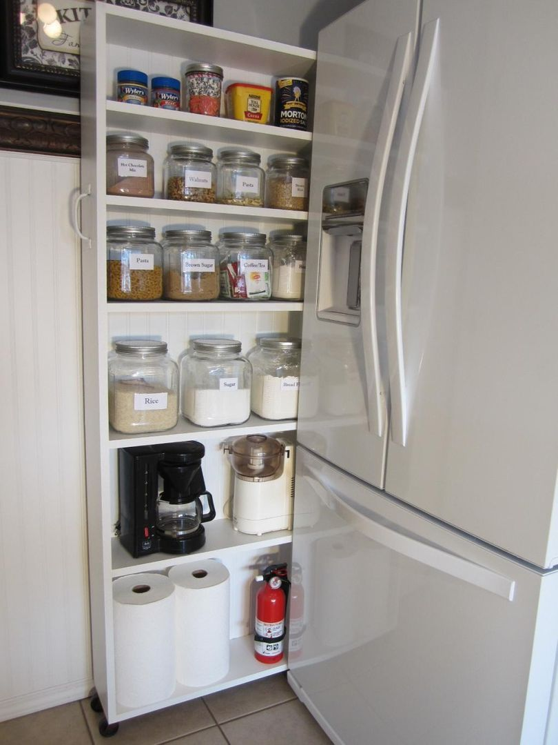 DIY Rolling Pantry Tucks Into Space by Fridge - Rolling pantry, Diy pantry, Kitchen pantry cabinets, Diy kitchen, Pantry cabinet, Diy pantry organization - Do you have an empty space in your kitchen next to your refrigerator  If you do, and want to make good use of that space, you might want to add this rolling pantry to your honeydo list  I wish I c…