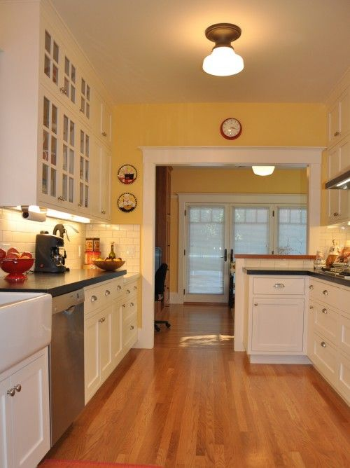 White Kitchen Yellow Cabinets yellow walls, check! white cabinets, check! light wood flooring