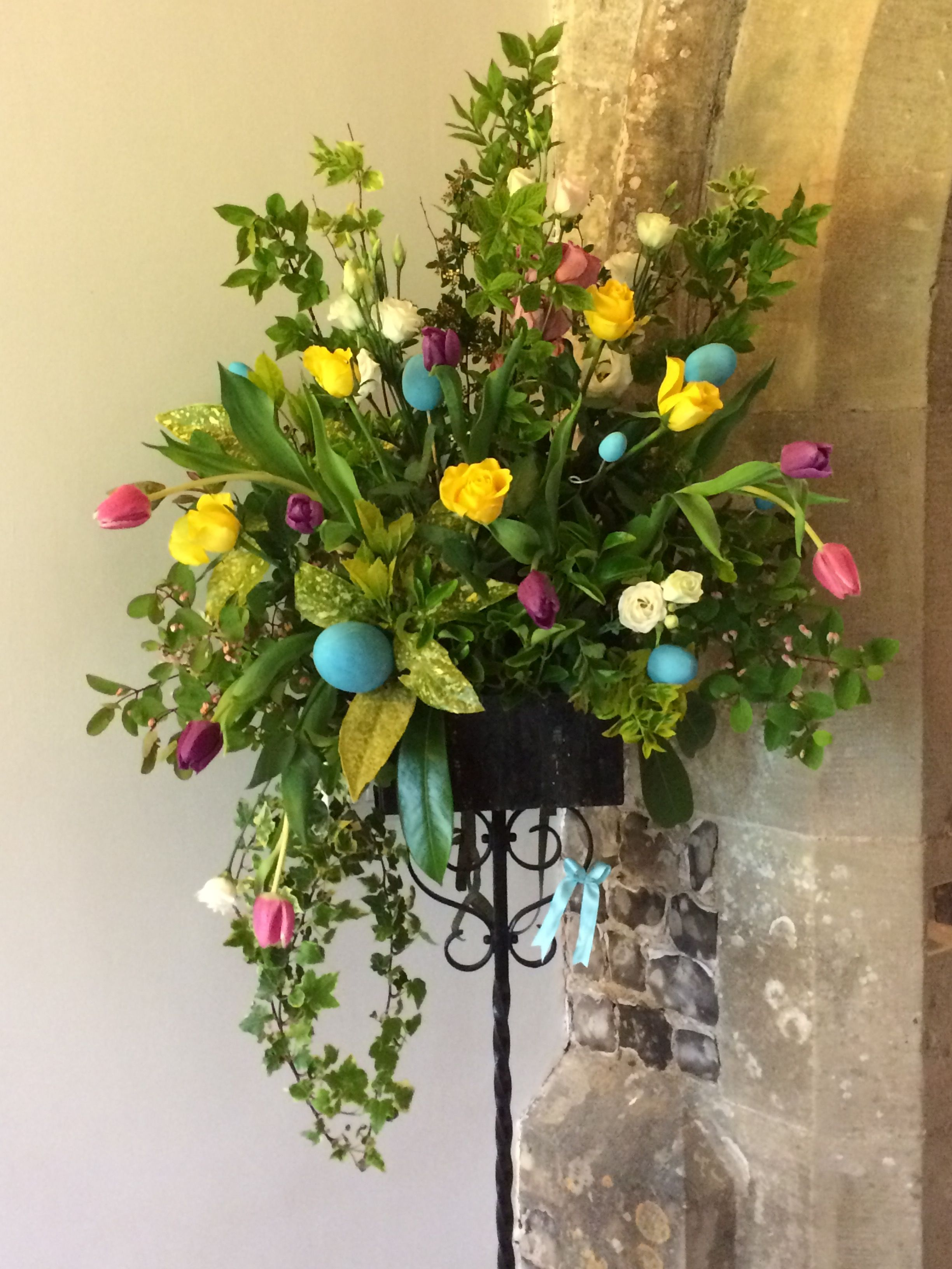 Bright spring Easter pedestal floral arrangement.