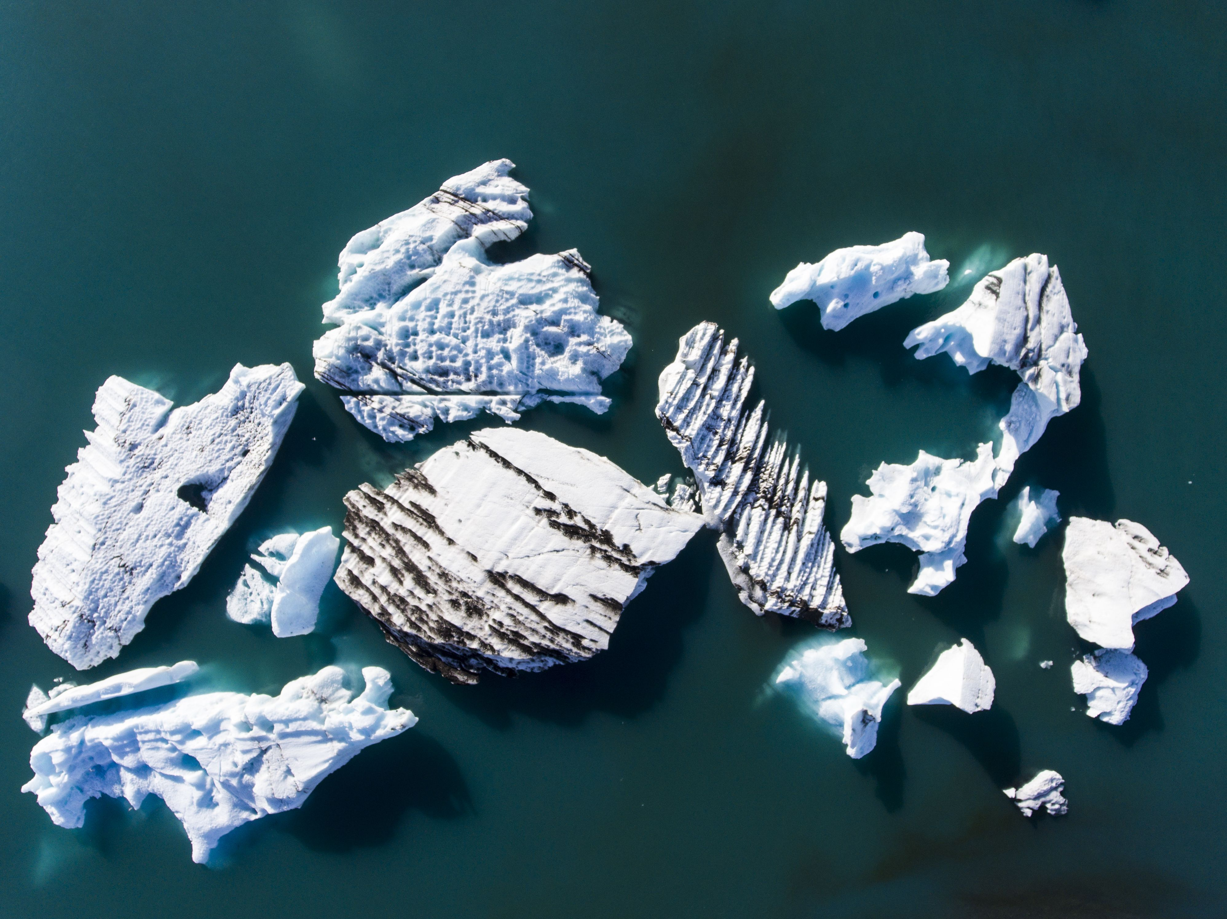 Chunks of ice in an Icelandic glacial lagoon reveal ages of wear and tear in this National Geographic Your Shot Photo of the Day.