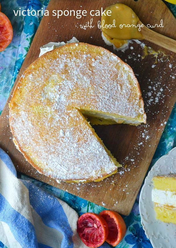 A Victoria Sponge Cake with sweet cream and blood orange curd. Easy to make and absolutely amazing!