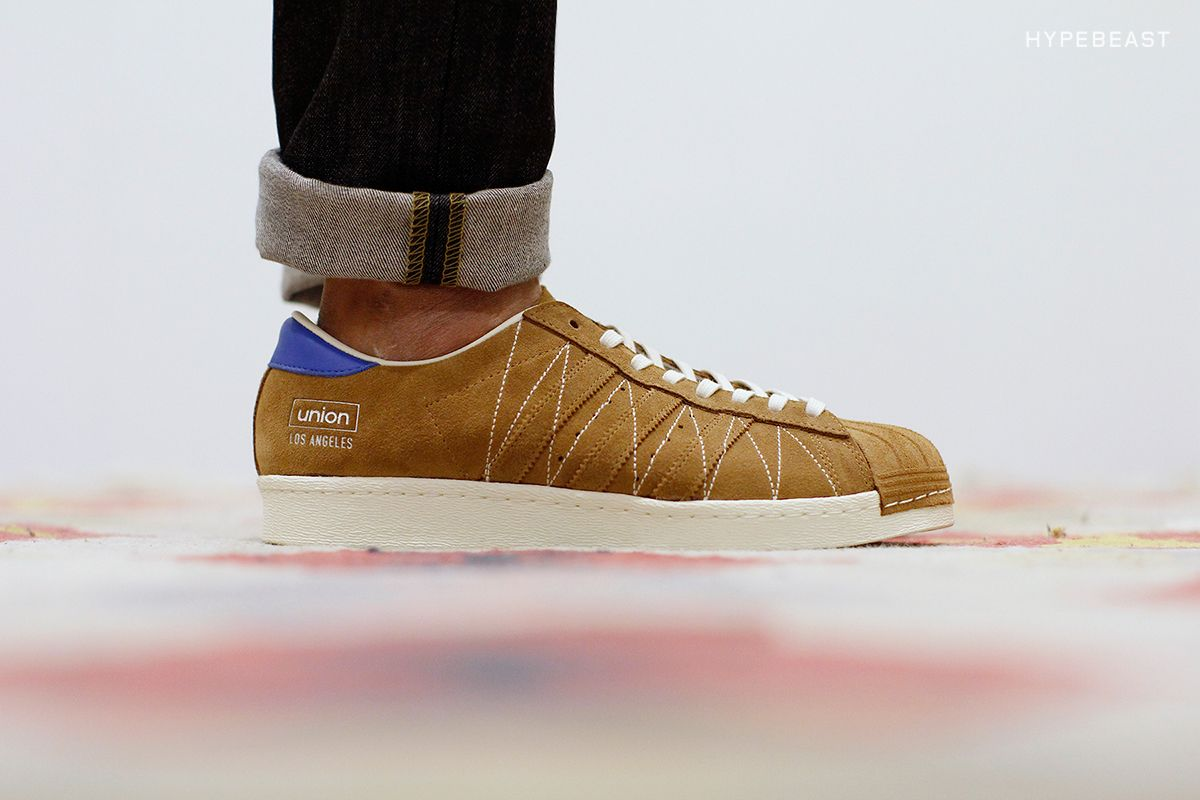 After unveilinga collaboration with UNDFTD for its 10th anniversary, we now get a closer look at the UNDFTD x adidas Consortium Superstar. The classic silhouette is reimagined with a brown suede uppe...