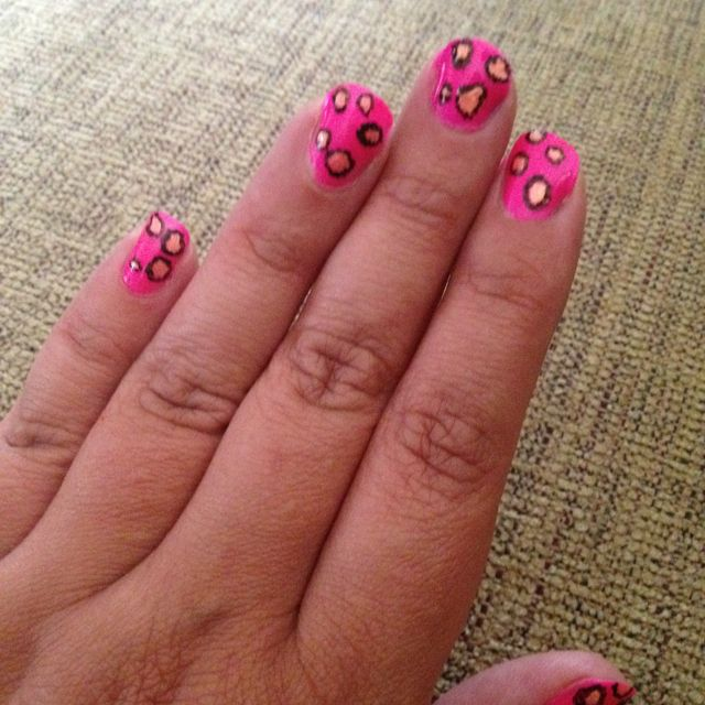 Pink polish with leopard print nails.